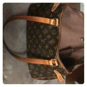Genuine Louis Vuitton with gentle wear on edges